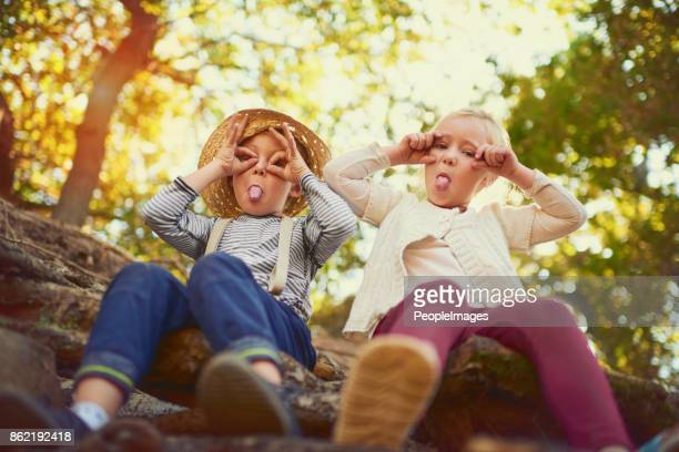 they're just being silly - under tongue stock pictures, royalty-free photos & images