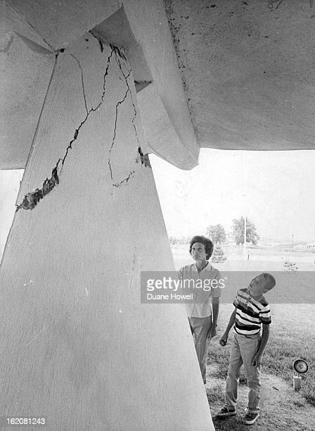 AUG 9 1967 They're Looking at one of three pillars that cracked during Earthquake viewing me damage is Mrs 10728 Roseanna' Drive and Ted Niemi of...