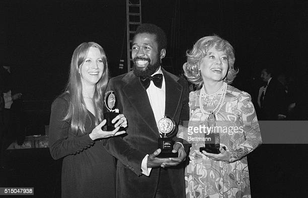 They're Real Tony New York Julie Harris Ben Vereen and Glynis Johns beam happily as they hold Broadway Theater's Tony Awards presentation here Miss...