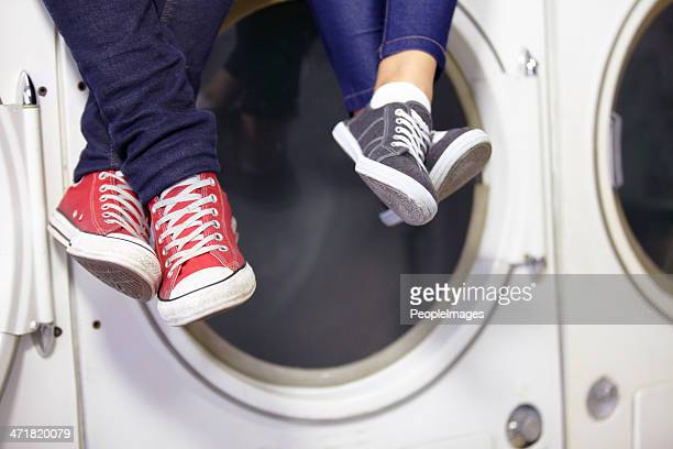 they're relaxed while doing laundry - couples showering stock pictures, royalty-free photos & images