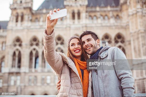 they're the sweetest couple ever! - town hall square stock pictures, royalty-free photos & images