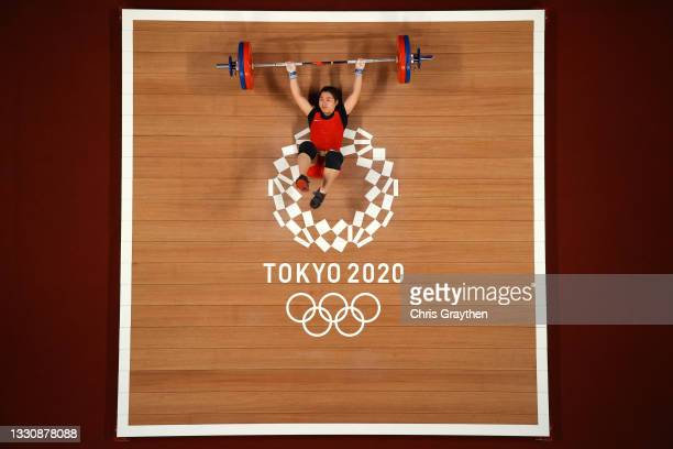 Thi Duyen Hoang of Team Vietnam competes during the Weightlifting - Women's 59kg Group A on day four of the Tokyo 2020 Olympic Games at Tokyo...
