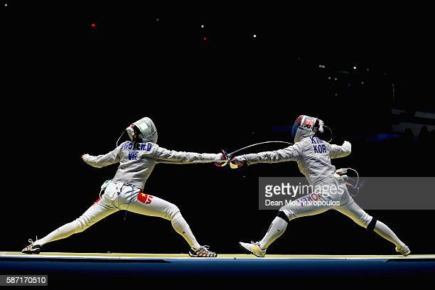 Thi Le Dung Nguyen of Vietnam and Jiyeon Kim of Korea compete during the Women's Individual Sabre on Day 3 of the Rio 2016 Olympic Games at Carioca...
