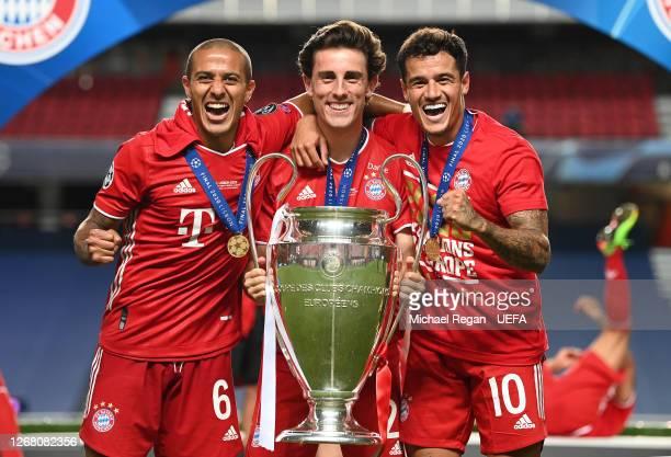 Thiago Alcantara Alvaro Odriozola and Philippe Coutinho of FC Bayern Munich celebrate with the UEFA Champions League Trophy following their team's...