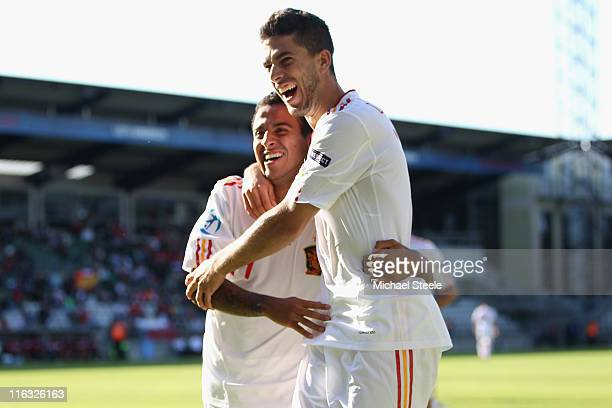 Thiago Alcantara and Didac Vila Rosello celebrate their sides second goal scored by Adrian during the UEFA European Under21 Championship Group B...