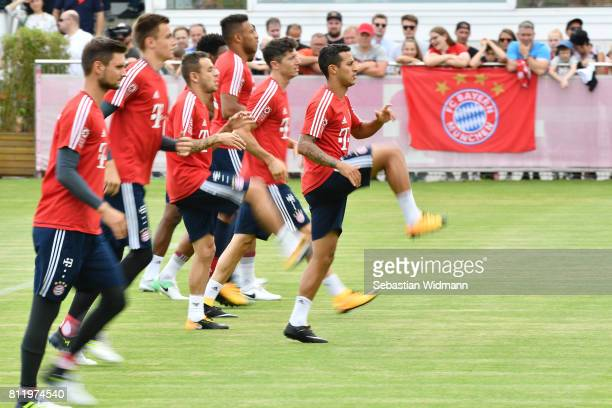 Thiago Alcantara and fellow players of FC Bayern Muenchen run during a training session at Saebener Strasse training ground on July 10 2017 in Munich...