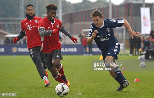 Thiago Alcantara and Kingsley Coman of FC Bayern Muenchen challenge Bert Callens of the Paulaner Soccer Team during the Paulaner Fan Dream Bavarian...