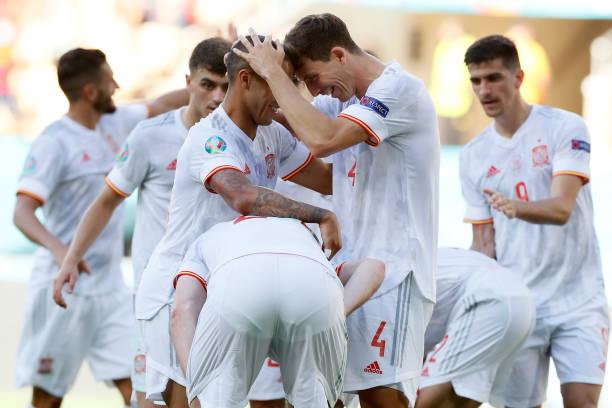 Thiago Alcantara and Pau Torres of Spain celebrate their side's fifth goal, an own goal by Juraj Kucka of Slovakia during the UEFA Euro 2020...