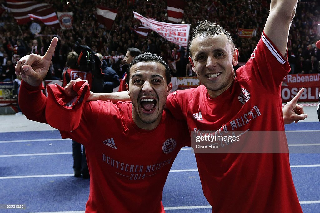 Thiago Alcantara (L) and Rafinha (R) of Munich celebrates after the Bundesliga match between and Hertha BSC and FC Bayern Muenchen at Olympiastadion on March 25, 2014 in Berlin, Germany.