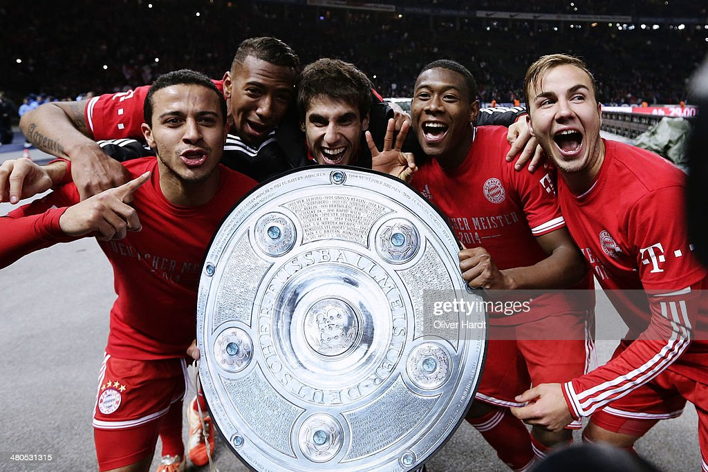 Thiago Alcantara (L) , Jerome Boateng, Javi Martinez , David Alaba and Mario Goetze (R) of Munich celebrates after the Bundesliga match between and Hertha BSC and FC Bayern Muenchen at Olympiastadion on March 25, 2014 in Berlin, Germany.