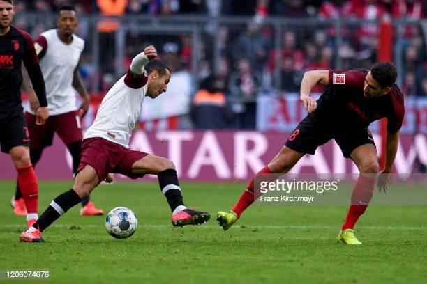 Thiago Alcantara Nascimiento of Bayern Muenchen and Rani Khedira of FC Augsburg during the Bundesliga match between FC Bayern Muenchen and FC...