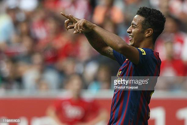 Thiago Alcantara of Barcelona celebrates the first goal during the Audi Cup match between FC Barcelona and International de Porto Alegre at Allianz...