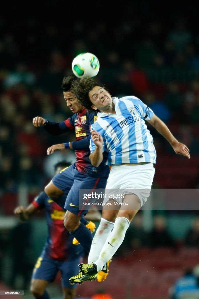 Thiago Alcantara of Barcelona FC competes for the ball with Manuel Ronaldo Iturra of Malaga CF during the Copa del Rey Quarter Final match between Barcelona FC and Malaga CF at Camp Nou on January 16, 2013 in Barcelona, Spain.