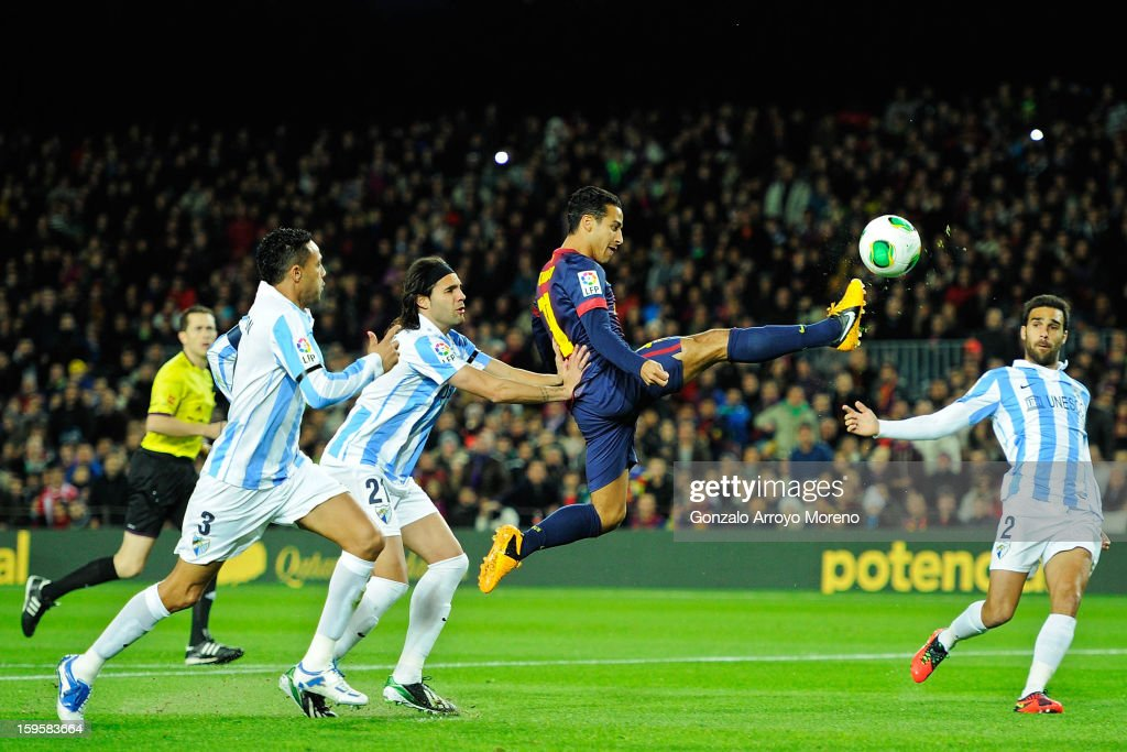Thiago Alcantara of Barcelona FC strikes the ball trough Weligton Robson (L) of Malaga CF and his teammates Sergio Sanchez (2ndL) and Jesus Gamez (R) during the Copa del Rey Quarter Final match between Barcelona FC and Malaga CF at Camp Nou on January 16, 2013 in Barcelona, Spain.