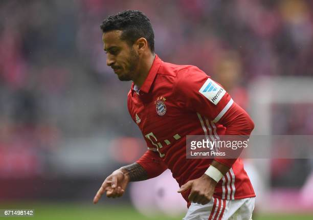 Thiago Alcantara of Bayern Muenchen celebrates scoring his side's second goal during the Bundesliga match between Bayern Muenchen and 1 FSV Mainz 05...