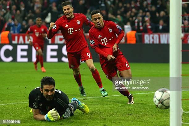 Thiago Alcantara of Bayern Muenchen celebrates scoring his team's third goal past Gianluigi Buffon of Juventus during the UEFA Champions League round...