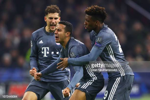 Thiago Alcantara of Bayern Muenchen celebrates winning a penalty with David Alaba and Leon Goretzka during the UEFA Champions League Group E match...