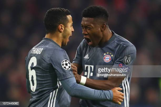 Thiago Alcantara of Bayern Muenchen celebrates winning a penalty with David Alaba during the UEFA Champions League Group E match between Ajax and FC...