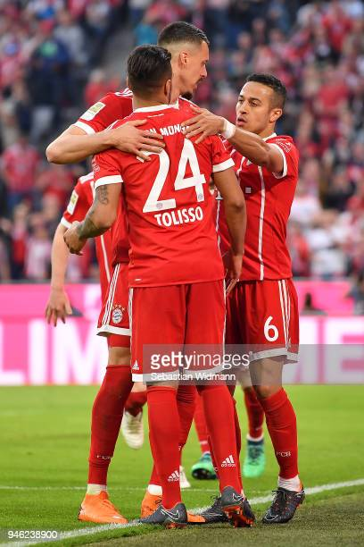 Thiago Alcantara of Bayern Muenchen celebrates with Sandro Wagner of Muenchen and Tolisso of Bayern Muenchen after he scored a goal to make it 31...