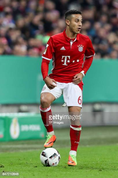 Thiago Alcantara of Bayern Muenchen controls the ball during the DFB Cup quarter final between Bayern Muenchen and FC Schalke 04 at Allianz Arena on...
