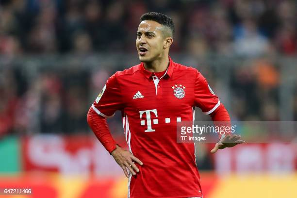 Thiago Alcantara of Bayern Muenchen gestures during the DFB Cup quarter final between Bayern Muenchen and FC Schalke 04 at Allianz Arena on March 1...
