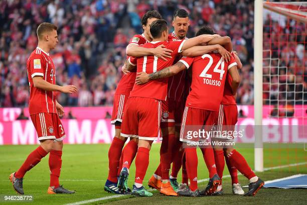 Thiago Alcantara of Bayern Muenchen is celebrates by his team after he scored a goal to make it 31 during the Bundesliga match between FC Bayern...