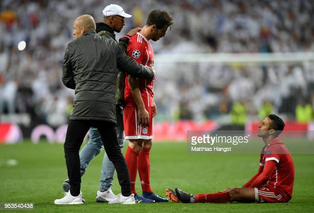 Thiago Alcantara of Bayern Muenchen is consoled by Arjen Robben Jerome Boateng and Javi Martinez of Bayern Muenchen as they fail to reach the final...