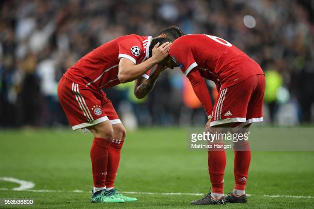 Thiago Alcantara of Bayern Muenchen is consoled by James Rodriguez of Bayern Muenchen as they fail to reach the final after the UEFA Champions League...