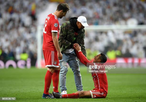 Thiago Alcantara of Bayern Muenchen is consoled by Jerome Boateng and Javi Martinez of Bayern Muenchen as they fail to reach the final after the UEFA...
