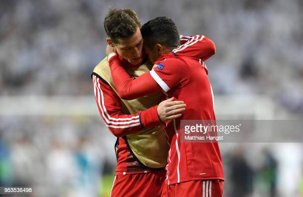 Thiago Alcantara of Bayern Muenchen is consoled by Sebastian Rudy of Bayern Muenchen as they fail to reach the final after the UEFA Champions League...