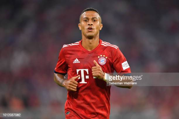 Thiago Alcantara of Bayern Muenchen plays the ball during the friendly match between Bayern Muenchen and Manchester United at Allianz Arena on August...