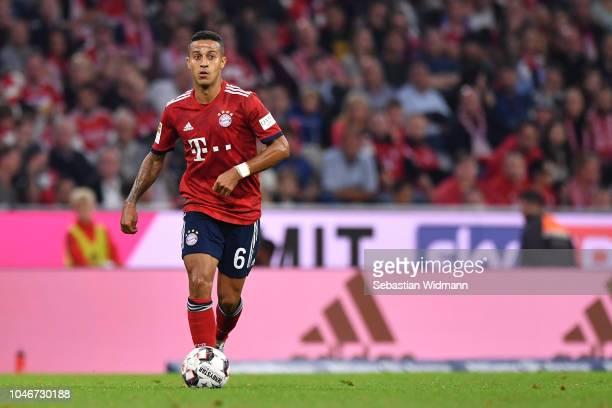 Thiago Alcantara of Bayern Muenchen plays the ball during the Bundesliga match between FC Bayern Muenchen and Borussia Moenchengladbach at Allianz...