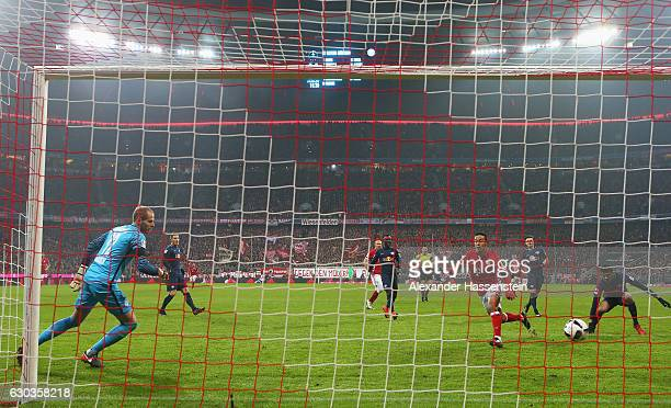 Thiago Alcantara of Bayern Muenchen scores his sides first goal during the Bundesliga match between Bayern Muenchen and RB Leipzig at Allianz Arena...