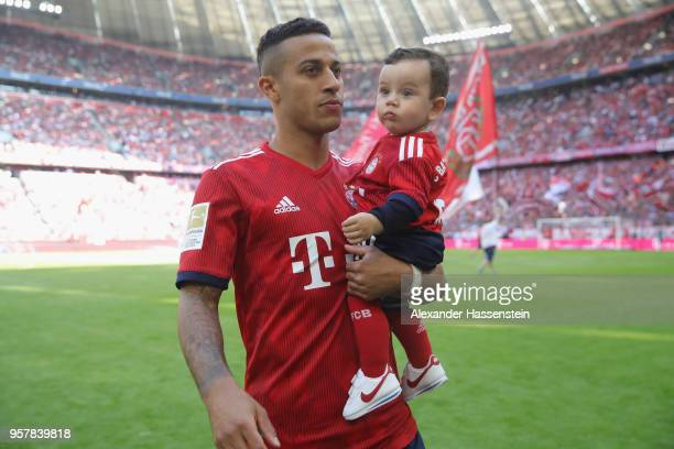 Thiago Alcantara of Bayern Muenchen with his son prior to the Bundesliga match between FC Bayern Muenchen and VfB Stuttgart at Allianz Arena on May...