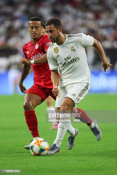 Thiago Alcantara of Bayern Munich and Eden Hazard of Real Madrid during the 2019 International Champions Cup match between FC Bayern Munich and Real...