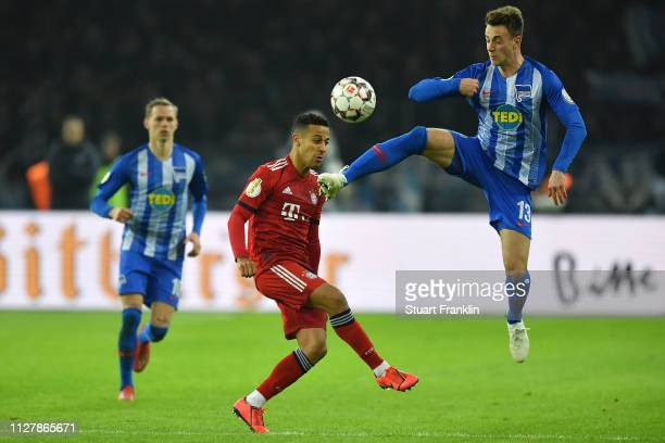 Thiago Alcantara of Bayern Munich and Lukas Kluenter of Hertha BSC clash during the DFB Cup match between Hertha BSC and FC Bayern Muenchen at...