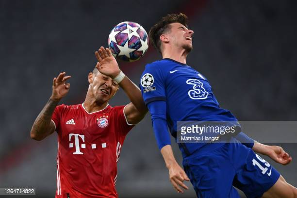 Thiago Alcantara of Bayern Munich battles for possession in the air with Mason Mount of Chelsea during the UEFA Champions League round of 16 second...