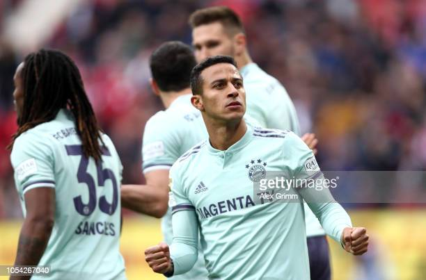 Thiago Alcantara of Bayern Munich celebrates after scoring his team's second goal during the Bundesliga match between 1 FSV Mainz 05 and FC Bayern...