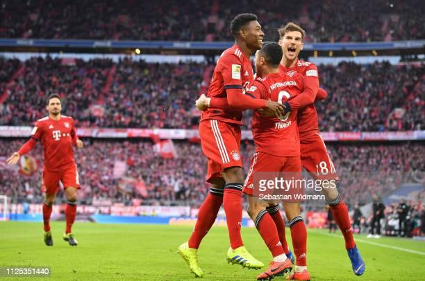 Thiago Alcantara of Bayern Munich celebrates after scoring his team's first goal with David Alaba and Leon Goretzka during the Bundesliga match...