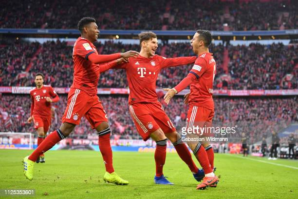 Thiago Alcantara of Bayern Munich celebrates after scoring his team's first goal with David Alaba and Leon Goretzka during the Bundesliga match...