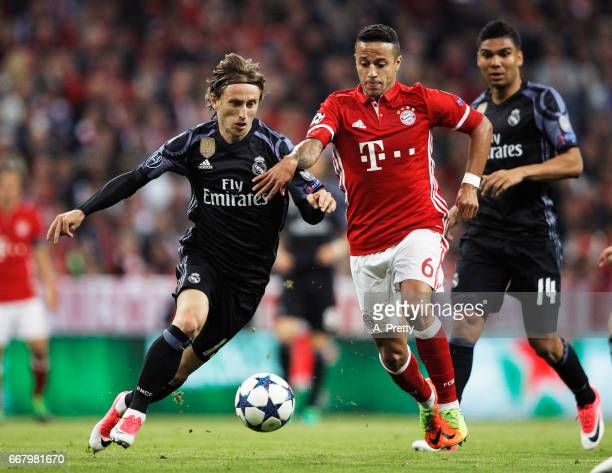 Thiago Alcantara of Bayern Munich is challenged by Luka Modric of Real Madrid during the UEFA Champions League Quarter Final first leg match between...
