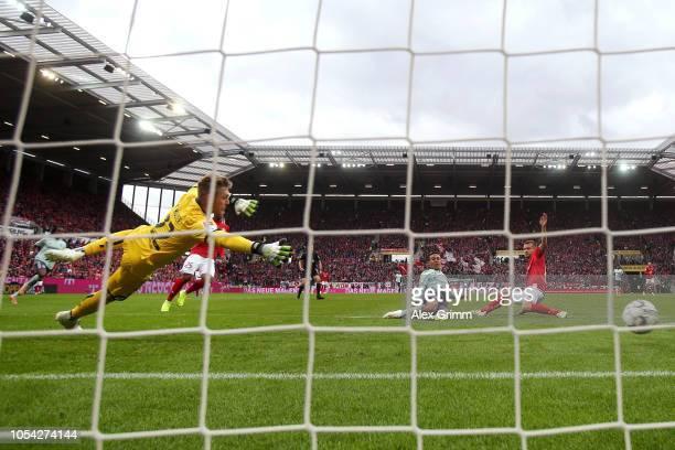 Thiago Alcantara of Bayern Munich scores his team's second goal during the Bundesliga match between 1 FSV Mainz 05 and FC Bayern Muenchen at Opel...