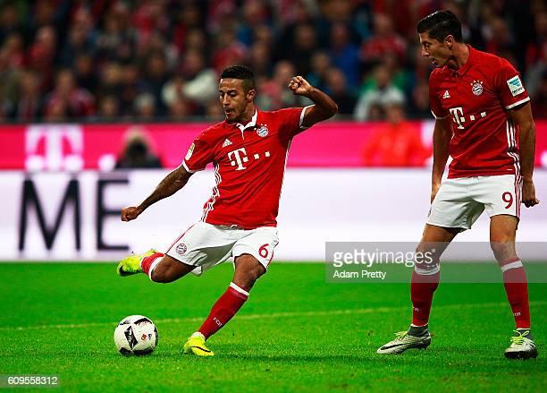 Thiago Alcantara of Bayern Munich shows Robert Lewandowski how to score a goal during the Bundesliga match between Bayern Muenchen and Hertha BSC at...