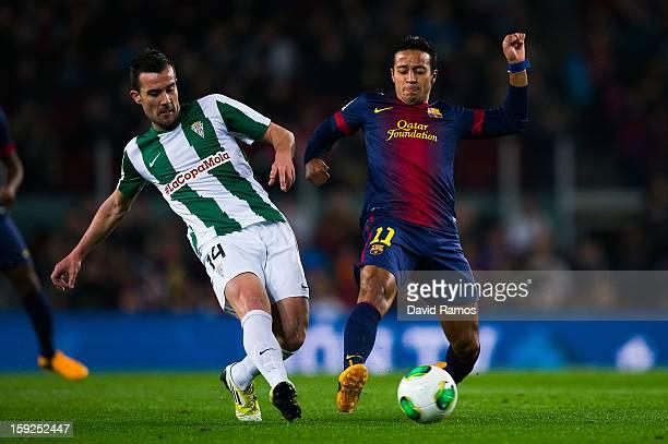 Thiago Alcantara of FC Barcelona duels for the ball with Artiz Lopez Garai of Cordoba CF during the Copa del Rey round of sixteen second leg match...