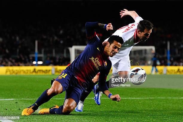 Thiago Alcantara of FC Barcelona duels for the ball with Fernando Navarro of Sevilla FC during the La Liga match between FC Barcelona and Sevilla FC...
