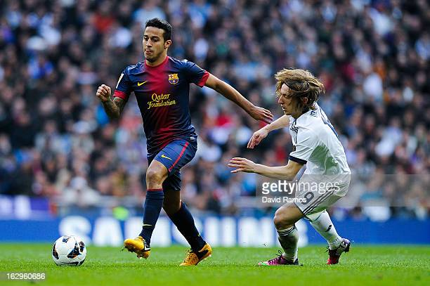 Thiago Alcantara of FC Barcelona duels for the ball with Luka Modric of Real Madrid CF during the La Liga match between Real Madrid CF and FC...