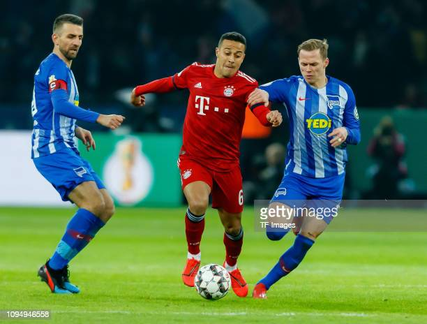Thiago Alcantara of FC Bayern Muenchen and Ondrej Duda of Hertha BSC battle for the ball during the round of 16 DFB Pokal match between Hertha BSC...