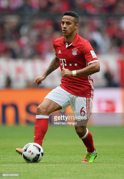 Thiago Alcantara of FC Bayern Muenchen controls the ball during the Bundesliga match between Bayern Muenchen and FC Augsburg at Allianz Arena on...