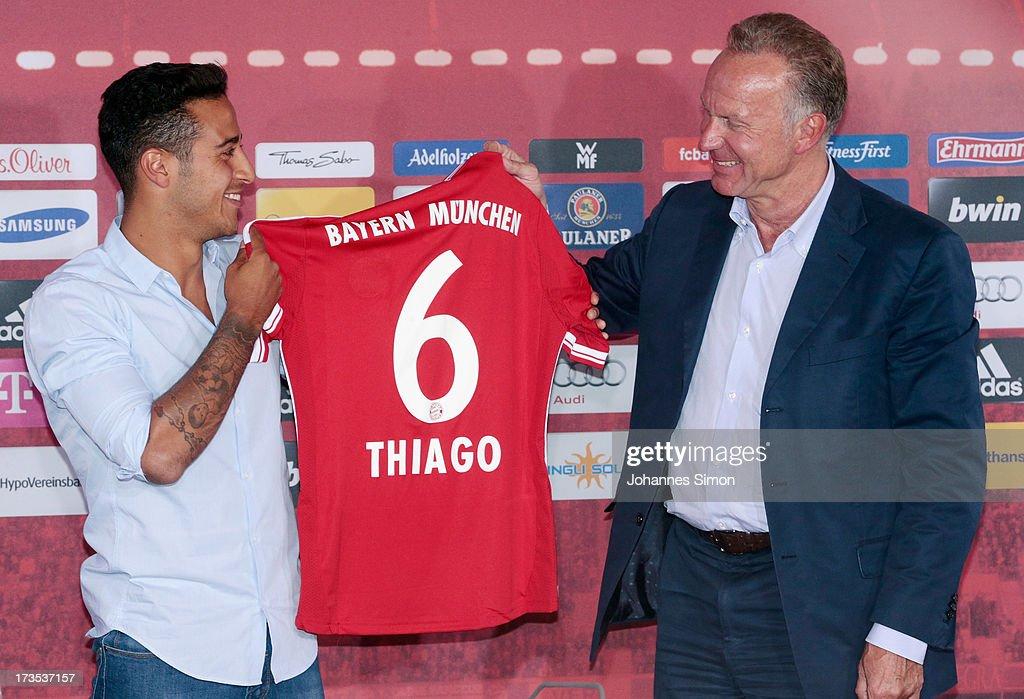 release date a7930 e88ac Thiago Alcantara of FC Bayern Muenchen presents his new ...