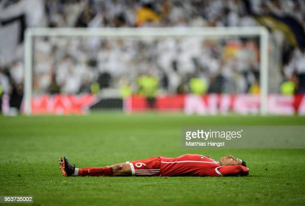 Thiago Alcantara of FC Bayern Muenchen shows his disappointment after the UEFA Champions League Semi Final Second Leg match between Real Madrid and...